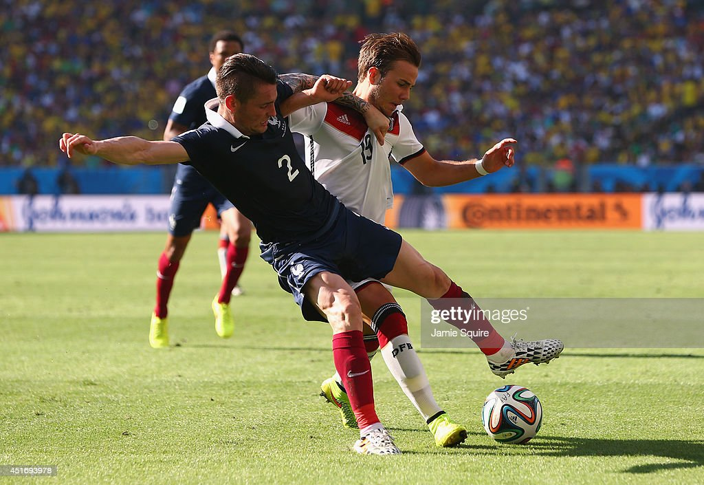 Mathieu Debuchy of France and Mario Goetze of Germany compete for the ball during the 2014 FIFA World Cup Brazil Quarter Final match between France...