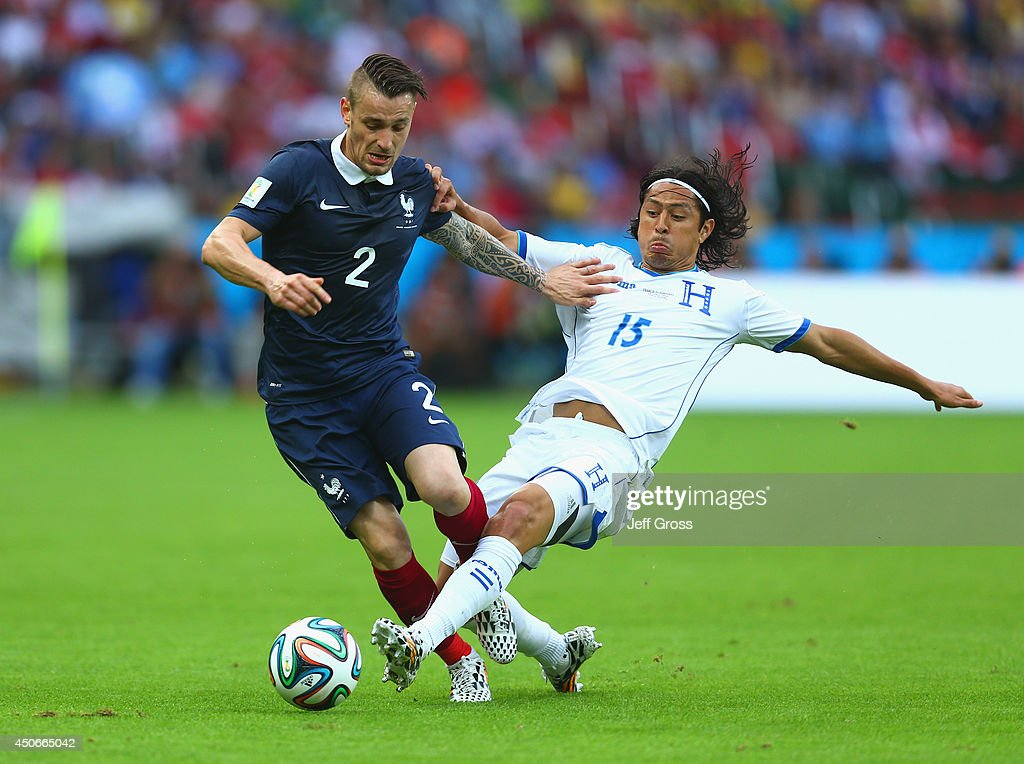 Mathieu Debuchy of France holds off a challenge by Roger Espinoza of Honduras during the 2014 FIFA World Cup Brazil Group E match between France and Honduras at Estadio Beira-Rio on June 15, 2014 in Porto Alegre, Brazil.