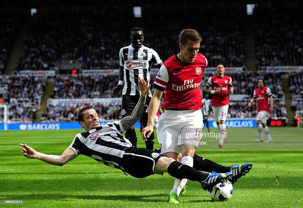 <a gi-track='captionPersonalityLinkClicked' href=/galleries/search?phrase=Mathieu+Debuchy&family=editorial&specificpeople=729104 ng-click='$event.stopPropagation()'>Mathieu Debuchy</a> of Newcastle in action against <a gi-track='captionPersonalityLinkClicked' href=/galleries/search?phrase=Aaron+Ramsey&family=editorial&specificpeople=4784114 ng-click='$event.stopPropagation()'>Aaron Ramsey</a> of Arsenal during the Barclays Premier League match between Newcastle United and Arsenal at St James' Park on May 19, 2013 in Newcastle upon Tyne, England.