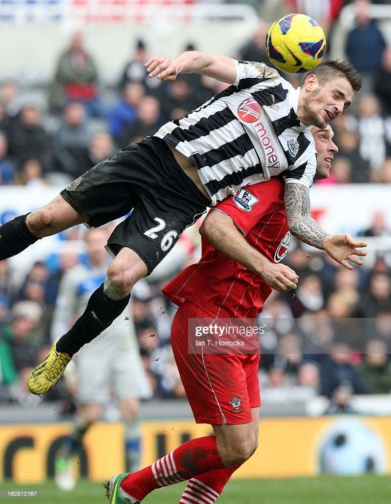 Mathieu Debuchy of Newcastle United heads the ball with Rickie Lambert challenging during the Barclays Premier League match between Newcastle United and Southampton at St James' Park on February 24, 2013 in Newcastle upon Tyne, England.