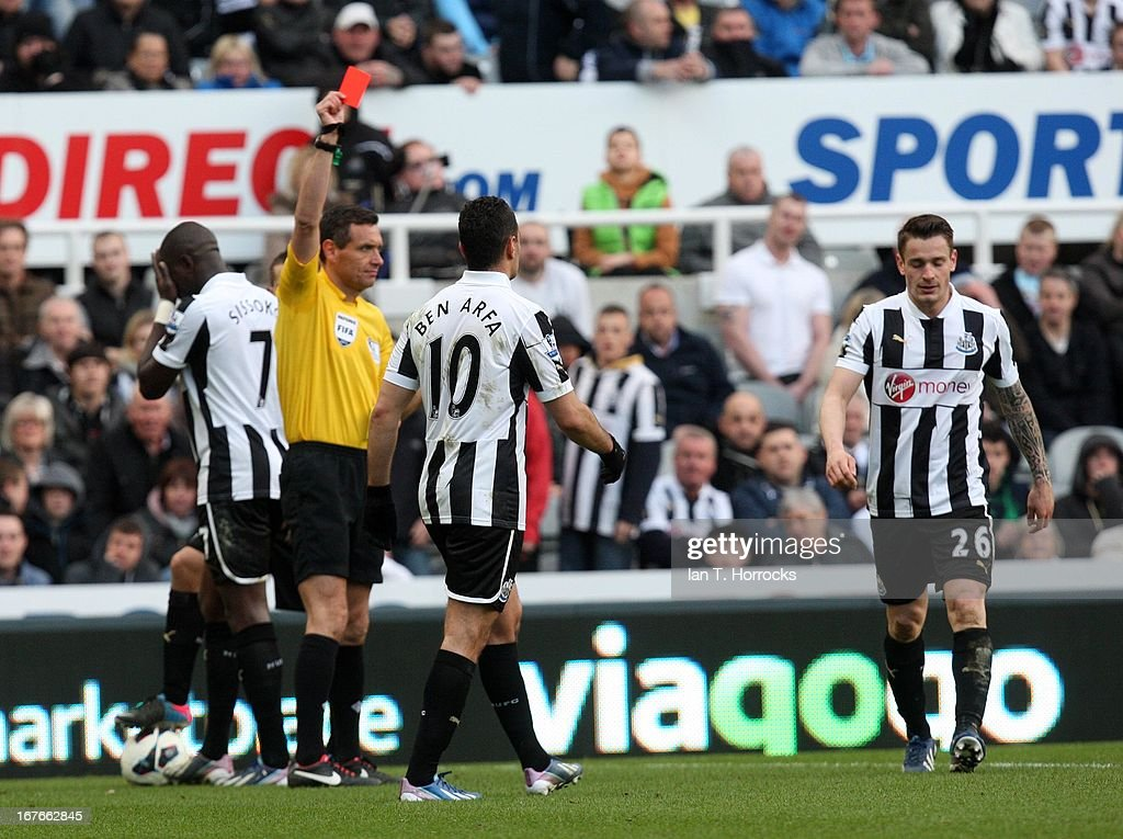 <a gi-track='captionPersonalityLinkClicked' href=/galleries/search?phrase=Mathieu+Debuchy&family=editorial&specificpeople=729104 ng-click='$event.stopPropagation()'>Mathieu Debuchy</a> (far right) of Newcastle United is sent off during a the Barclays Premier League match between Newcastle United and Liverpool at St James' Park on April 27, in Newcastle upon Tyne, England.