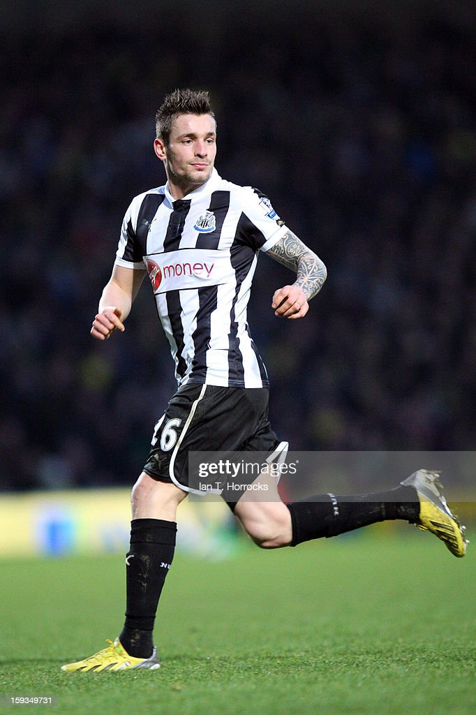 <a gi-track='captionPersonalityLinkClicked' href=/galleries/search?phrase=Mathieu+Debuchy&family=editorial&specificpeople=729104 ng-click='$event.stopPropagation()'>Mathieu Debuchy</a> of Newcastle United makes his debut during the Barclays Premier League match between Norwich City and Newcastle United at Carrow Road on January 12, 2013 in Norwich, England.