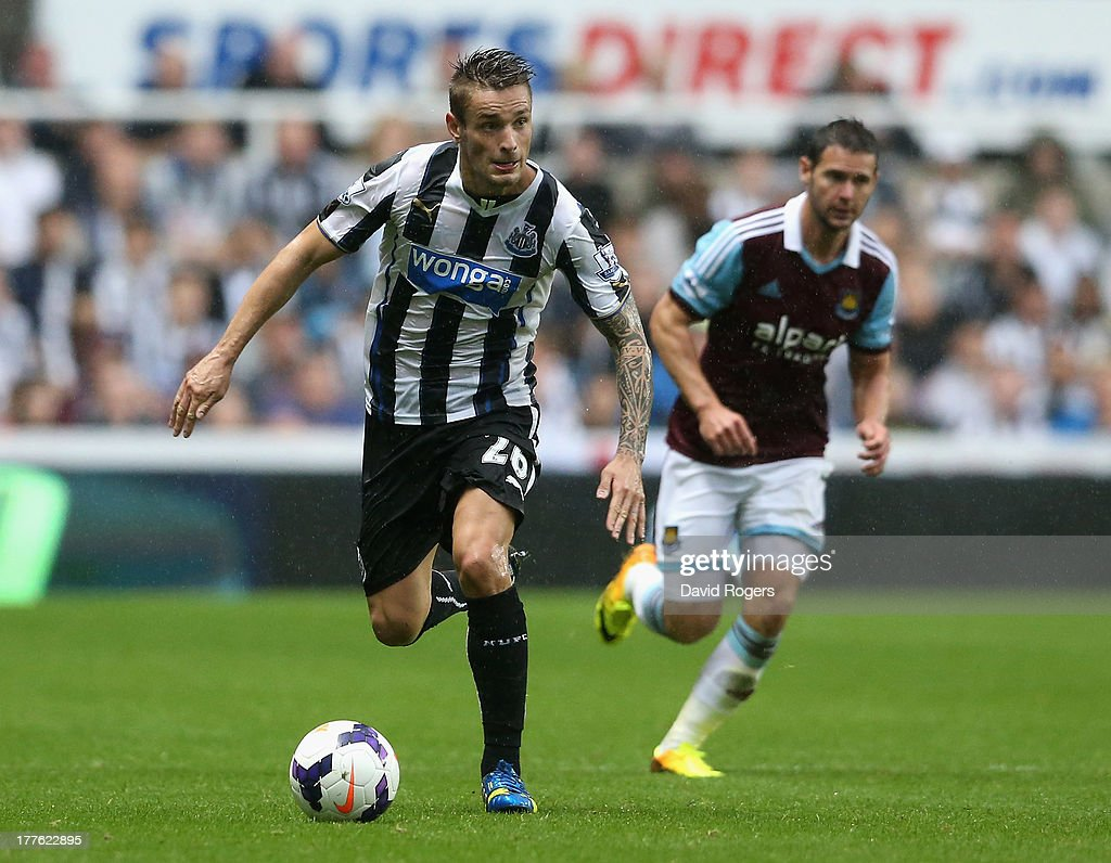 Mathieu Debuchy of Newcastle United runs with the ball during the Barclays Premier League match between Newcastle United and West Ham United at St James' Park on August 24, 2013 in Newcastle upon Tyne, England.