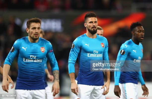 Mathieu Debuchy Olivier Giroud and Danny Welbeck of Arsenal looks on during the UEFA Europa League group H match between 1 FC Koeln and Arsenal FC at...