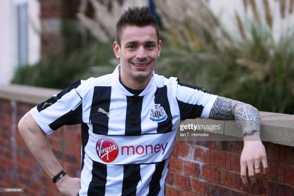 <a gi-track='captionPersonalityLinkClicked' href=/galleries/search?phrase=Mathieu+Debuchy&family=editorial&specificpeople=729104 ng-click='$event.stopPropagation()'>Mathieu Debuchy</a> poses after signing for Newcastle United at the Little Benton Training ground on January 04, 2013 in Newcastle upon Tyne, England.