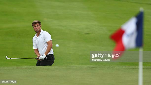 Mathieu DecottigniesLafon of France chips onto the 12th green during day one of the 100th Open de France at Le Golf National on June 30 2016 in Paris...