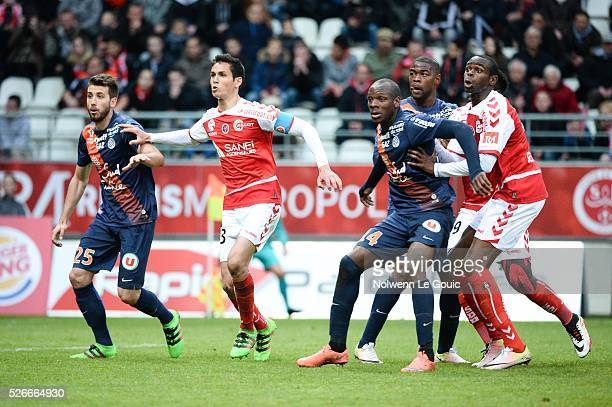 Mathieu Deplagne Bryan Dabo and William Remy of Montpellier and Aissa Mandi and Prince Oniangue of Reims during the French Ligue 1 match between...