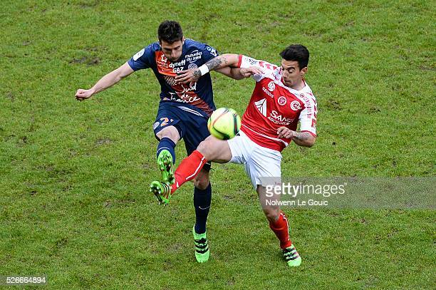 Mathieu Deplagne of Montpellier and Diego Rigonato of Reims during the French Ligue 1 match between Stade de Reims and Montpellier Herault SC at...