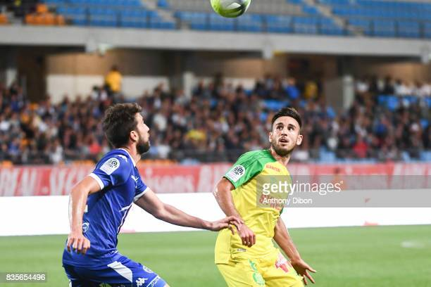 Mathieu Deplagne of Troyes and Adrien Thomasson of Nantes during the Ligue 1 match between Troyes Estac and FC Nantes at Stade de l'Aube on August 19...