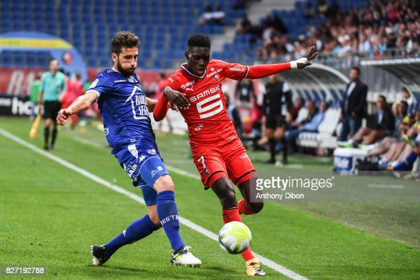Mathieu Deplagne of Troyes and Ismaila Sarr of Rennes during the Ligue 1 match between Troyes AC and Stade Rennais at Stade de l'Aube on August 5...