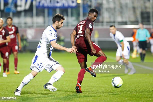 Mathieu Deplagne of Troyes and Opa Nguette of Metz during the Ligue 1 match between Metz and Troyes AC at on September 23 2017 in Metz France
