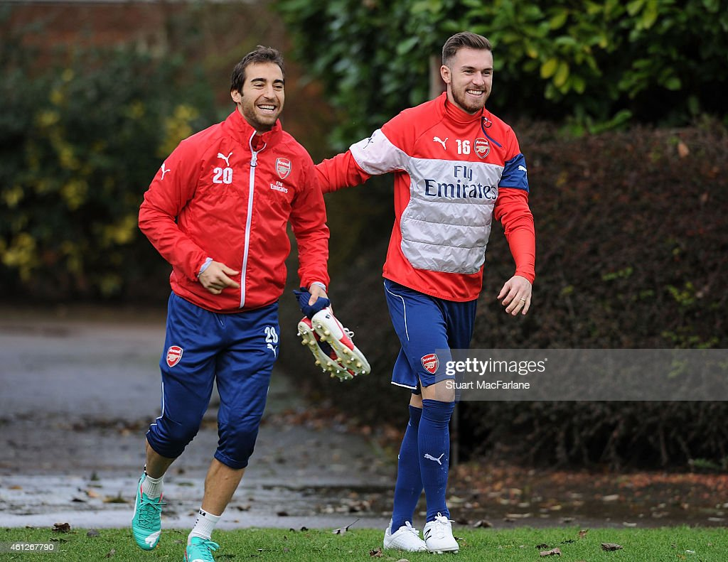 Mathieu Flamini and Aaron Ramsey of Arsenal before a training session at London Colney on January 10, 2015 in St Albans, England.