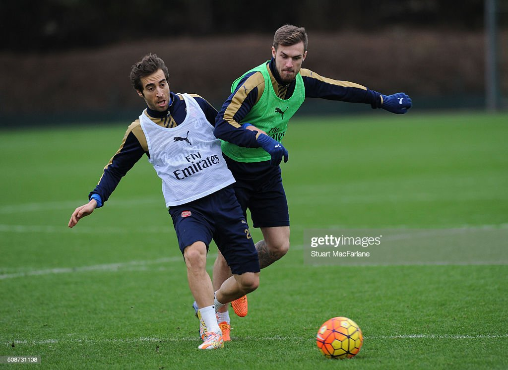 <a gi-track='captionPersonalityLinkClicked' href=/galleries/search?phrase=Mathieu+Flamini&family=editorial&specificpeople=242961 ng-click='$event.stopPropagation()'>Mathieu Flamini</a> and <a gi-track='captionPersonalityLinkClicked' href=/galleries/search?phrase=Aaron+Ramsey&family=editorial&specificpeople=4784114 ng-click='$event.stopPropagation()'>Aaron Ramsey</a> of Arsenal during a training session at London Colney on February 6, 2016 in St Albans, England.