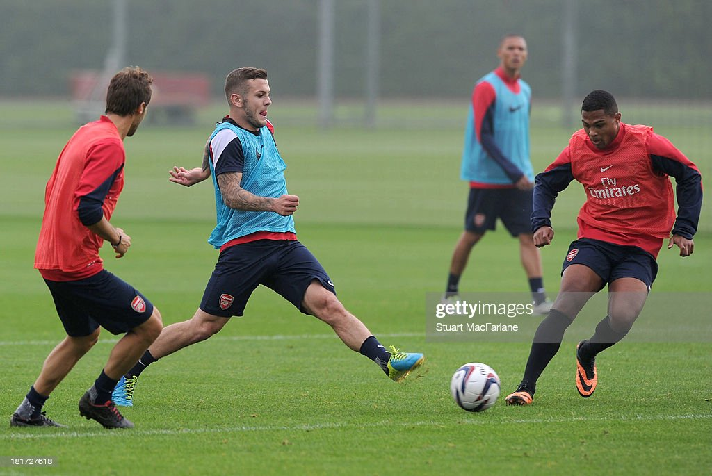 Mathieu Flamini, Jack Wilshere and Serge Gnabry of Arsenal during a training session at London Colney on September 24, 2013 in St Albans, England.