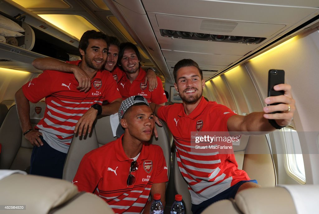 <a gi-track='captionPersonalityLinkClicked' href=/galleries/search?phrase=Mathieu+Flamini&family=editorial&specificpeople=242961 ng-click='$event.stopPropagation()'>Mathieu Flamini</a>, <a gi-track='captionPersonalityLinkClicked' href=/galleries/search?phrase=Nacho+Monreal&family=editorial&specificpeople=4078049 ng-click='$event.stopPropagation()'>Nacho Monreal</a>, <a gi-track='captionPersonalityLinkClicked' href=/galleries/search?phrase=Tomas+Rosicky&family=editorial&specificpeople=213988 ng-click='$event.stopPropagation()'>Tomas Rosicky</a>, <a gi-track='captionPersonalityLinkClicked' href=/galleries/search?phrase=Kieran+Gibbs&family=editorial&specificpeople=4192585 ng-click='$event.stopPropagation()'>Kieran Gibbs</a> and <a gi-track='captionPersonalityLinkClicked' href=/galleries/search?phrase=Aaron+Ramsey+-+Soccer+Player&family=editorial&specificpeople=4784114 ng-click='$event.stopPropagation()'>Aaron Ramsey</a> of Arsenal at Luton Airport on July 23, 2014 in Luton, England.