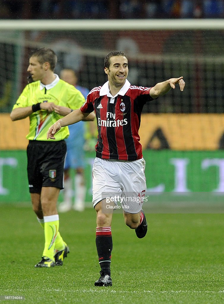 Mathieu Flamini of AC Milan celebrates scoring the first goal during the Serie A match between AC Milan and Calcio Catania at San Siro Stadium on April 28, 2013 in Milan, Italy.