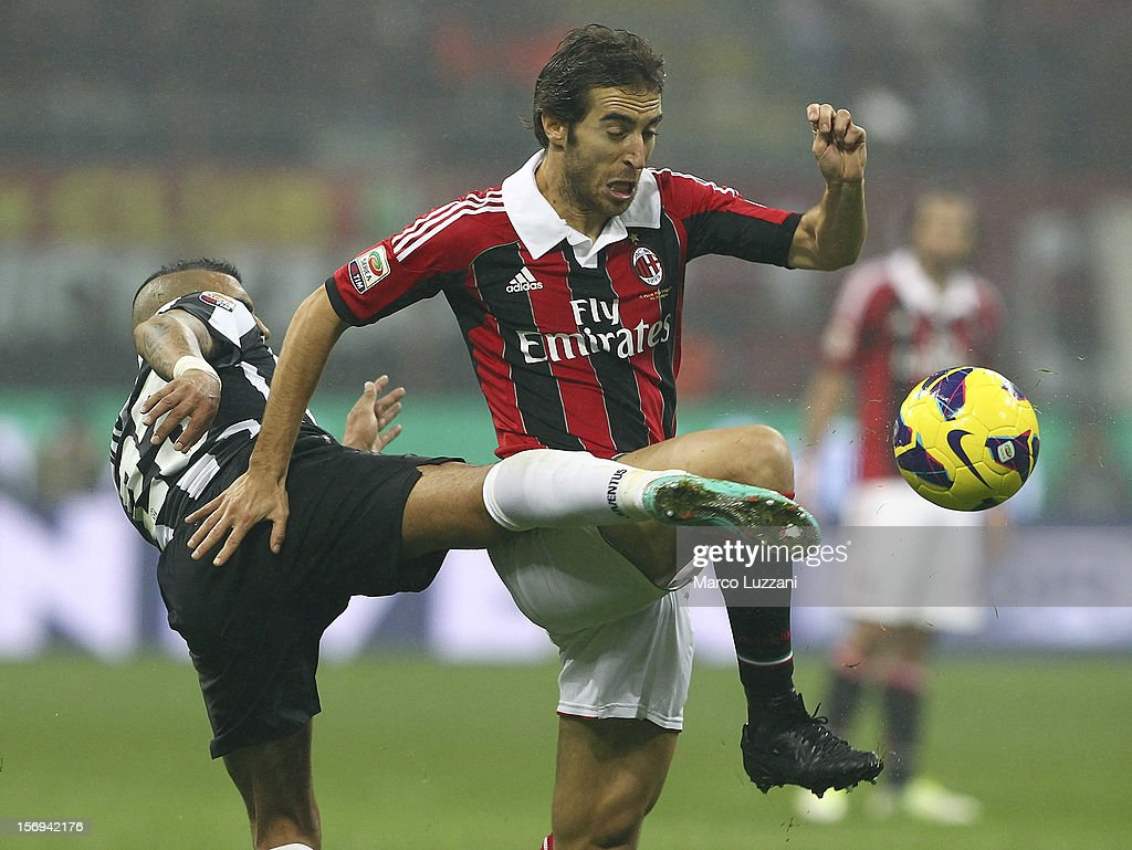 Mathieu Flamini (R) of AC Milan competes for the ball with Arturo Vidal (L) of Juventus FC during the Serie A match between AC Milan and Juventus FC at San Siro Stadium on November 25, 2012 in Milan, Italy.