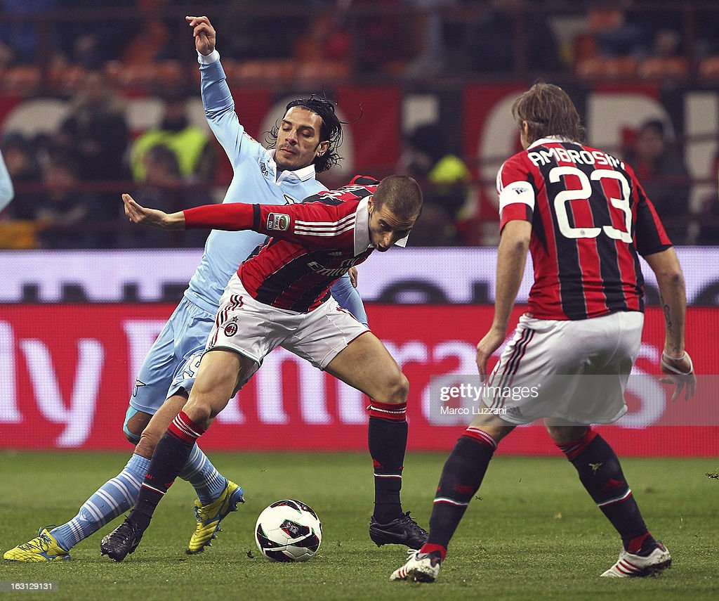 <a gi-track='captionPersonalityLinkClicked' href=/galleries/search?phrase=Mathieu+Flamini&family=editorial&specificpeople=242961 ng-click='$event.stopPropagation()'>Mathieu Flamini</a> (C) of AC Milan competes for the ball with <a gi-track='captionPersonalityLinkClicked' href=/galleries/search?phrase=Sergio+Floccari&family=editorial&specificpeople=675401 ng-click='$event.stopPropagation()'>Sergio Floccari</a> (L) of S.S. Lazio during the Serie A match between AC Milan and S.S. Lazio at San Siro Stadium on March 2, 2013 in Milan, Italy.