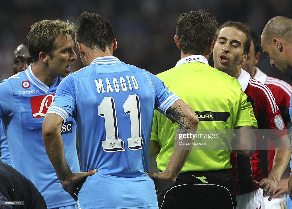 Mathieu Flamini (R) of AC Milan receives the red card from referee Referee Gianluca Rocchi (2nd R) during the Serie A match between AC Milan and SSC Napoli at San Siro Stadium on April 14, 2013 in Milan, Italy.