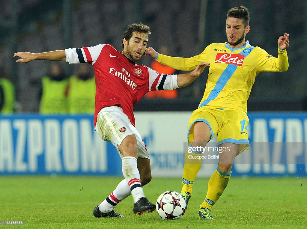 <a gi-track='captionPersonalityLinkClicked' href=/galleries/search?phrase=Mathieu+Flamini&family=editorial&specificpeople=242961 ng-click='$event.stopPropagation()'>Mathieu Flamini</a> of Arsenal and Dries Mertens in action during the UEFA Champions League Group F match between SSC Napoli and Arsenal at Stadio San Paolo on December 11, 2013 in Naples, Italy.
