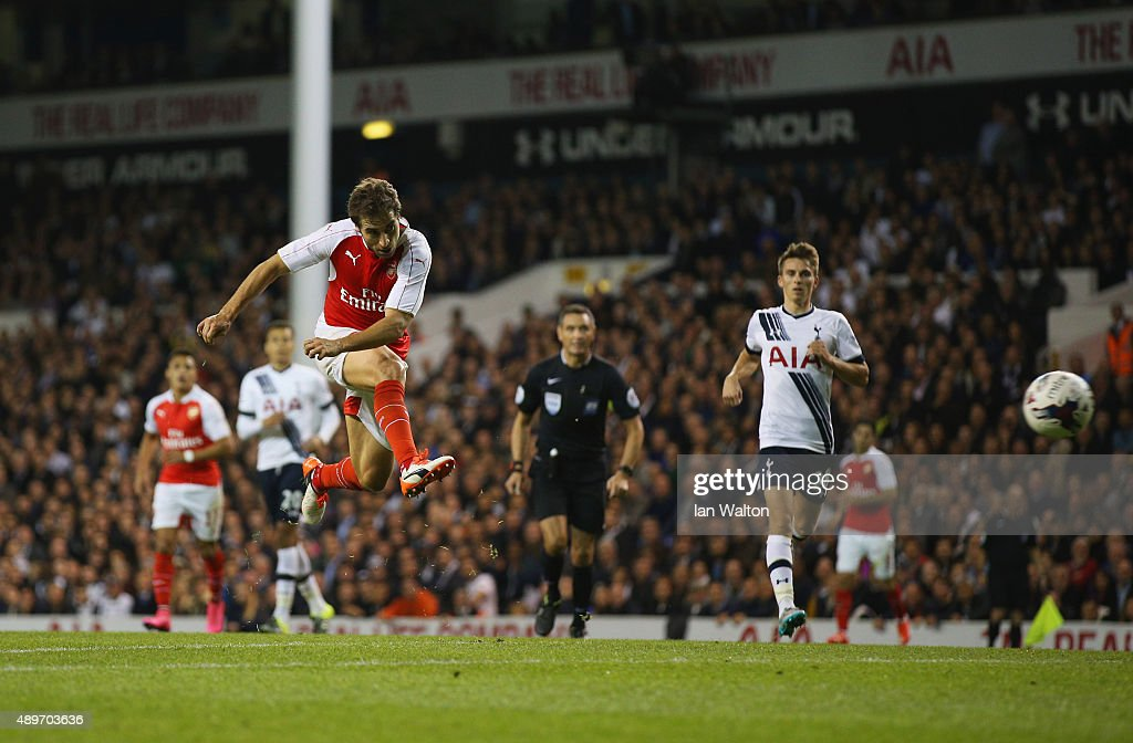<a gi-track='captionPersonalityLinkClicked' href=/galleries/search?phrase=Mathieu+Flamini&family=editorial&specificpeople=242961 ng-click='$event.stopPropagation()'>Mathieu Flamini</a> of Arsenal he scores their second goal during the Capital One Cup third round match between Tottenham Hotspur and Arsenal at White Hart Lane on September 23, 2015 in London, England.