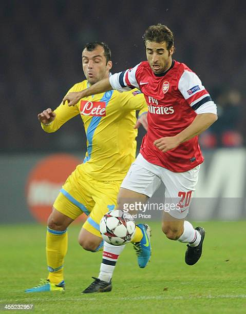 Mathieu Flamini of Arsenal is challenged by Goran Pandev of Napoli during the match Napoli against Arsenal in the UEFA Champions League at Stadio San...