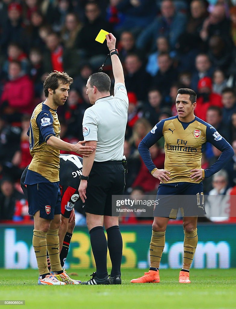 <a gi-track='captionPersonalityLinkClicked' href=/galleries/search?phrase=Mathieu+Flamini&family=editorial&specificpeople=242961 ng-click='$event.stopPropagation()'>Mathieu Flamini</a> of Arsenal is shown a yellow card by referee <a gi-track='captionPersonalityLinkClicked' href=/galleries/search?phrase=Kevin+Friend&family=editorial&specificpeople=2941162 ng-click='$event.stopPropagation()'>Kevin Friend</a> during the Barclays Premier League match between A.F.C. Bournemouth and Arsenal at the Vitality Stadium on February 7, 2016 in Bournemouth, England.