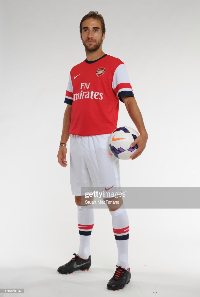 <a gi-track='captionPersonalityLinkClicked' href=/galleries/search?phrase=Mathieu+Flamini&family=editorial&specificpeople=242961 ng-click='$event.stopPropagation()'>Mathieu Flamini</a> of Arsenal poses during a portrait shoot as he is unveiled as a new signing at Emirates Stadium on August 28, 2013 in London, England.