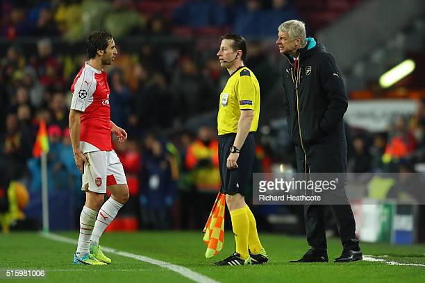Mathieu Flamini of Arsenal talks to manager Arsene Wenger after picking up an injury during the UEFA Champions League round of 16 second Leg match...