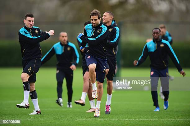 Mathieu Flamini of Arsenal warms up with team mates during an Arsenal training session ahead of the UEFA Champions League match against Olympiacos at...