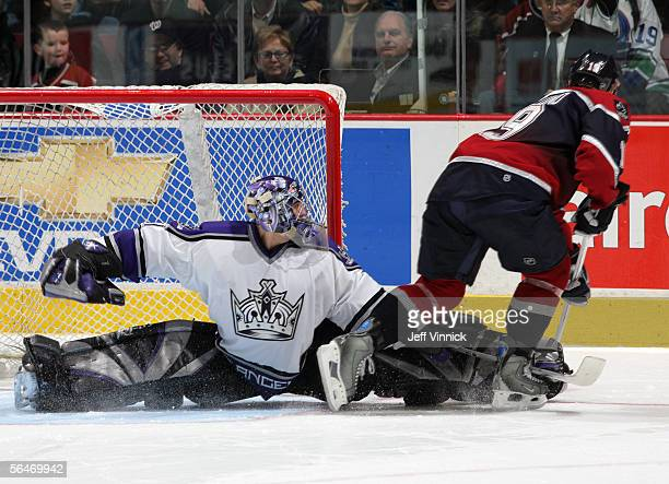 Mathieu Garon of the Los Angeles Kings makes a save on Markus Naslund of the Vancouver Canucks in the shootout during their NHL game at General...