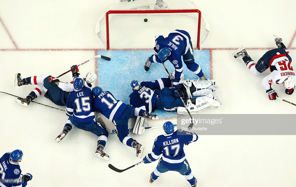 <a gi-track='captionPersonalityLinkClicked' href=/galleries/search?phrase=Mathieu+Garon&family=editorial&specificpeople=206119 ng-click='$event.stopPropagation()'>Mathieu Garon</a> #32 of the Tampa Bay Lightning can't make the stop against the the Washington Capitals in the third period at the Tampa Bay Times Forum on February 14, 2013 in Tampa, Florida.