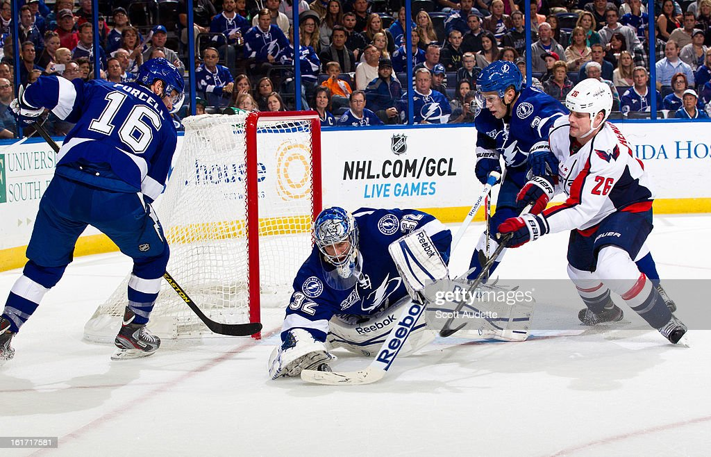 <a gi-track='captionPersonalityLinkClicked' href=/galleries/search?phrase=Mathieu+Garon&family=editorial&specificpeople=206119 ng-click='$event.stopPropagation()'>Mathieu Garon</a> #32 of the Tampa Bay Lightning dives to block a shot by <a gi-track='captionPersonalityLinkClicked' href=/galleries/search?phrase=Matt+Hendricks&family=editorial&specificpeople=4537275 ng-click='$event.stopPropagation()'>Matt Hendricks</a> #26 of the Washington Capitals during the second period of the game at the Tampa Bay Times Forum on February 14, 2013 in Tampa, Florida.