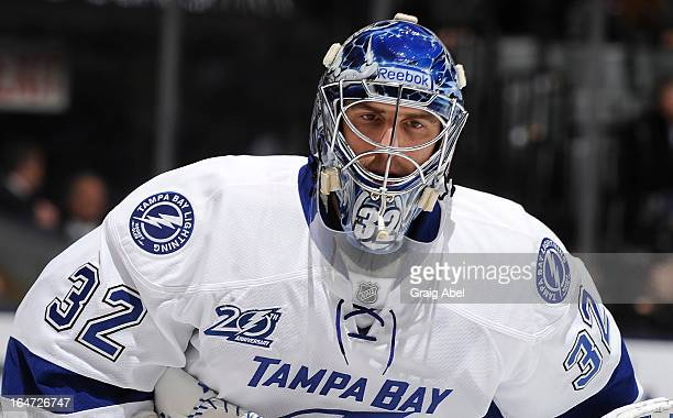 Mathieu Garon of the Tampa Bay Lightning looks on during NHL game action against the Toronto Maple Leafs March 20 2013 at the Air Canada Centre in...