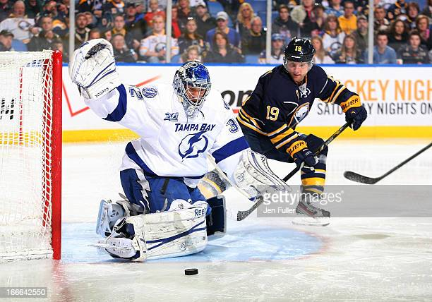 Mathieu Garon of the Tampa Bay Lightning makes a save in front of Cody Hodgson of the Buffalo Sabres on April 14 2013 at the First Niagara Center in...