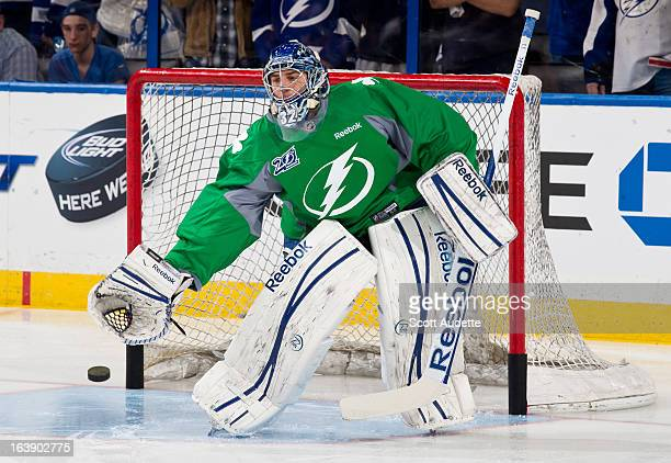 Mathieu Garon of the Tampa Bay Lightning skates during warm ups prior to the game against the Carolina Hurricanes at the Tampa Bay Times Forum on...