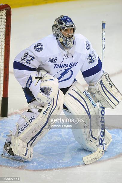 Mathieu Garon of the Tampa Bay Lightning takes shots during warm ups during a hockey game against the Washington Capitals on April 7 2013 at the...