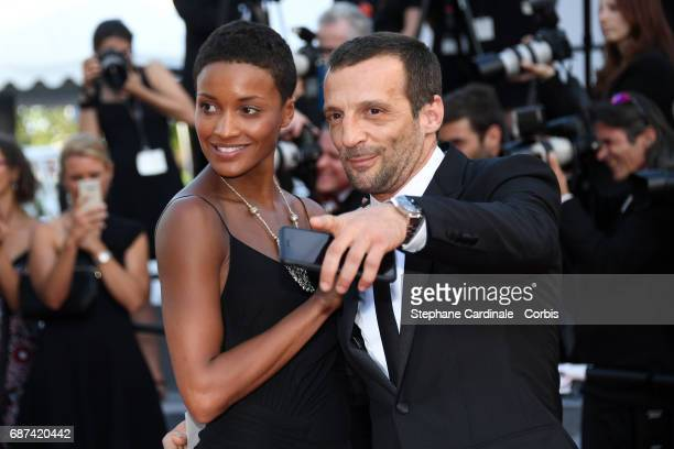 Mathieu Kassovitz and girlfriend Aude attends the 70th Anniversary of the 70th annual Cannes Film Festival at Palais des Festivals on May 23 2017 in...
