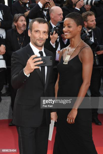 Mathieu Kassovitz and his guest attend the 70th anniversary event during the 70th annual Cannes Film Festival at Palais des Festivals on May 23 2017...