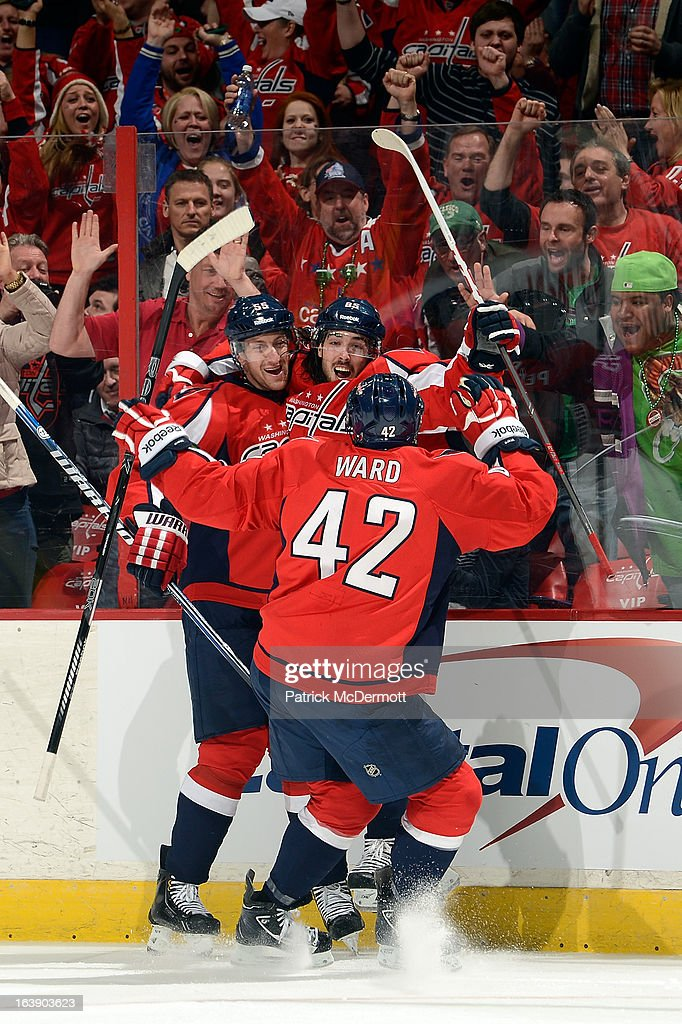 <a gi-track='captionPersonalityLinkClicked' href=/galleries/search?phrase=Mathieu+Perreault&family=editorial&specificpeople=776813 ng-click='$event.stopPropagation()'>Mathieu Perreault</a> #85 celebrates with Joel Ward #42 and Jeff Schultz #55 of the Washington Capitals after scoring a goal during the third period of an NHL game at Verizon Center on March 17, 2013 in Washington, DC.
