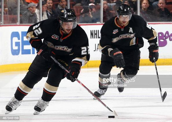 Mathieu Perreault of the Anaheim Ducks handles the puck as teammate Teemu Selanne follows behind during the game against the Winnipeg Jets on January...