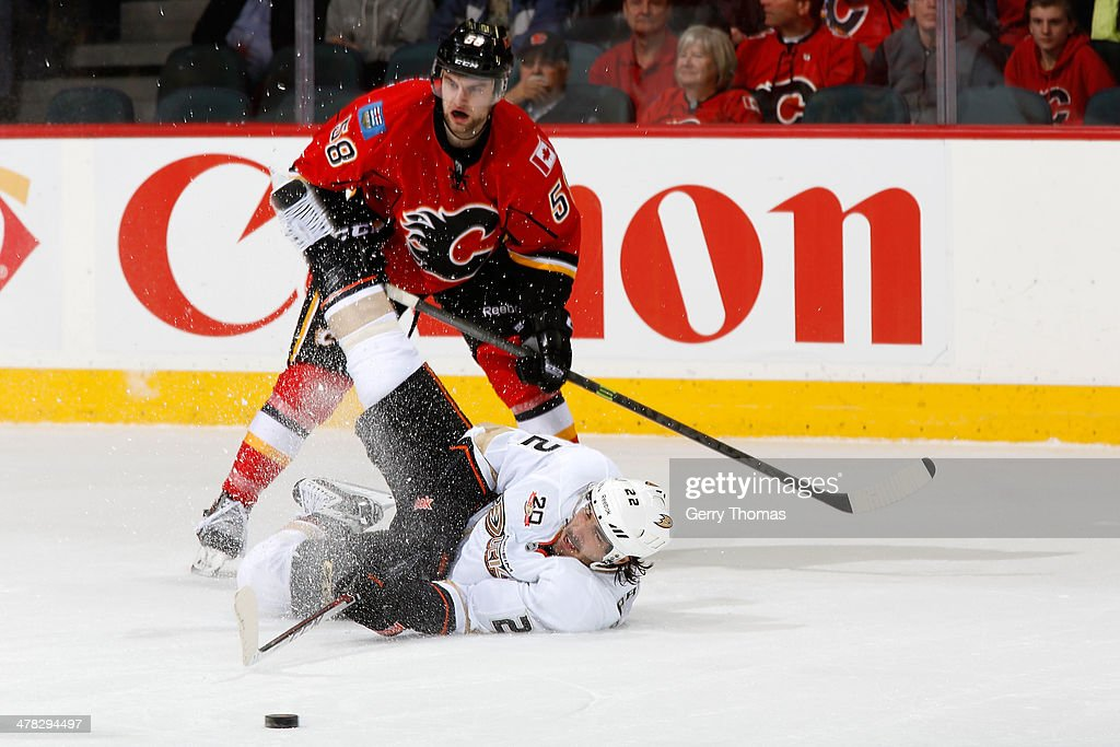 <a gi-track='captionPersonalityLinkClicked' href=/galleries/search?phrase=Mathieu+Perreault&family=editorial&specificpeople=776813 ng-click='$event.stopPropagation()'>Mathieu Perreault</a> #22 of the Anaheim Ducks is checked by <a gi-track='captionPersonalityLinkClicked' href=/galleries/search?phrase=Ben+Hanowski&family=editorial&specificpeople=5894592 ng-click='$event.stopPropagation()'>Ben Hanowski</a> #58 of the Calgary Flames at Scotiabank Saddledome on March 12, 2014 in Calgary, Alberta, Canada.