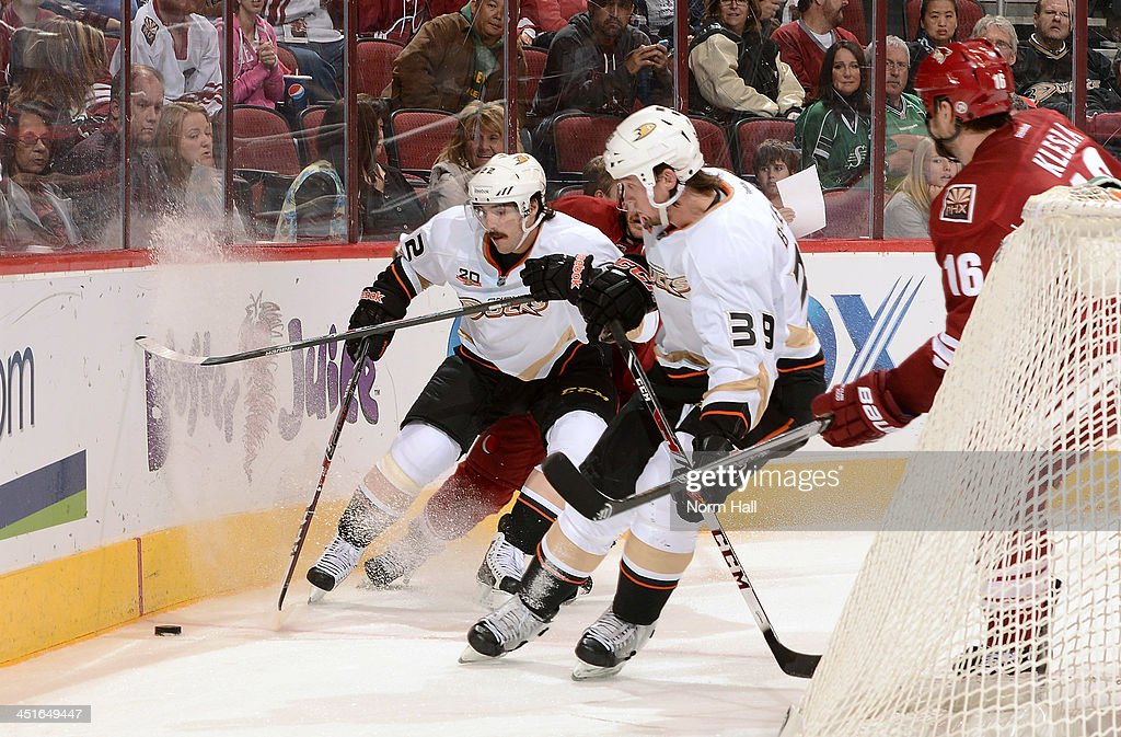 <a gi-track='captionPersonalityLinkClicked' href=/galleries/search?phrase=Mathieu+Perreault&family=editorial&specificpeople=776813 ng-click='$event.stopPropagation()'>Mathieu Perreault</a> #22 of the Anaheim Ducks skates the puck behind the net past teammate <a gi-track='captionPersonalityLinkClicked' href=/galleries/search?phrase=Matt+Beleskey&family=editorial&specificpeople=570471 ng-click='$event.stopPropagation()'>Matt Beleskey</a> #39 as <a gi-track='captionPersonalityLinkClicked' href=/galleries/search?phrase=Rostislav+Klesla&family=editorial&specificpeople=207079 ng-click='$event.stopPropagation()'>Rostislav Klesla</a> #16 of the Phoenix Coyotes defends during the third period at Jobing.com Arena on November 23, 2013 in Glendale, Arizona.