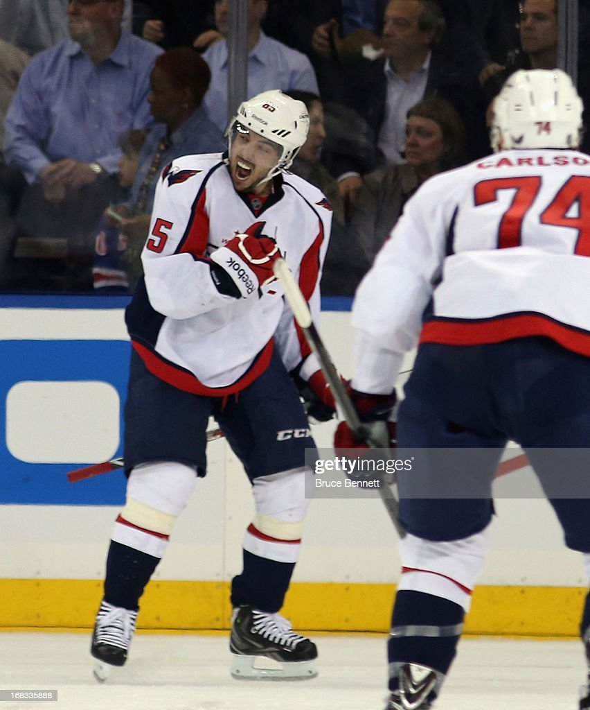 <a gi-track='captionPersonalityLinkClicked' href=/galleries/search?phrase=Mathieu+Perreault&family=editorial&specificpeople=776813 ng-click='$event.stopPropagation()'>Mathieu Perreault</a> #85 of the Washington Capitals celebrates his goal at 13:08 of the second period against the New York Rangers in Game Four of the Eastern Conference Quarterfinals during the 2013 NHL Stanley Cup Playoffs at Madison Square Garden on May 8, 2013 in New York City.