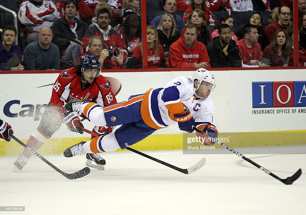 <a gi-track='captionPersonalityLinkClicked' href=/galleries/search?phrase=Mathieu+Perreault&family=editorial&specificpeople=776813 ng-click='$event.stopPropagation()'>Mathieu Perreault</a> #85 of the Washington Capitals trips up <a gi-track='captionPersonalityLinkClicked' href=/galleries/search?phrase=Mark+Streit&family=editorial&specificpeople=636976 ng-click='$event.stopPropagation()'>Mark Streit</a> #2 of the New York Islanders at the Verizon Center on February 28, 2012 in Washington, DC.