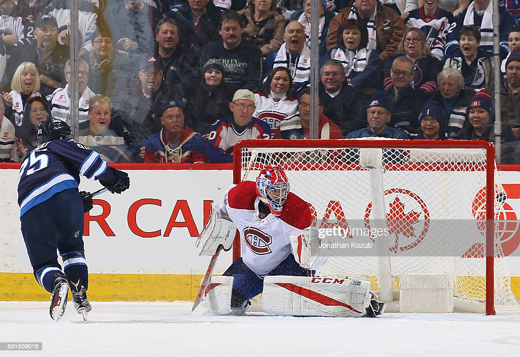 Mathieu Perreault #85 of the Winnipeg Jets bulges the twine behind goaltender Al Montoya #35 of the Montreal Canadiens for a first period goal at the MTS Centre on January 11, 2017 in Winnipeg, Manitoba, Canada.