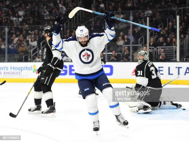 Mathieu Perreault of the Winnipeg Jets celebrates his goal in front of Ben Bishop and Derek Forbort of the Los Angeles Kings to take a 10 lead over...