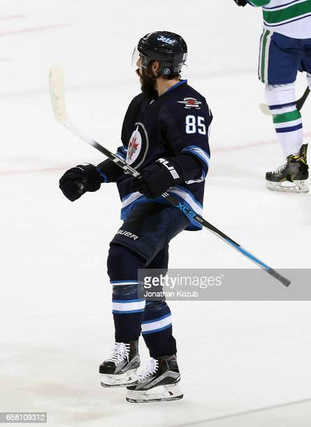 Mathieu Perreault of the Winnipeg Jets celebrates his second period goal against the Vancouver Canucks at the MTS Centre on March 26 2017 in Winnipeg...