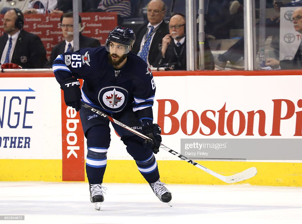 Mathieu Perreault #85 of the Winnipeg Jets follows the play down the ice during third period action against the Calgary Flames at the MTS Centre on March 11, 2017 in Winnipeg, Manitoba, Canada.