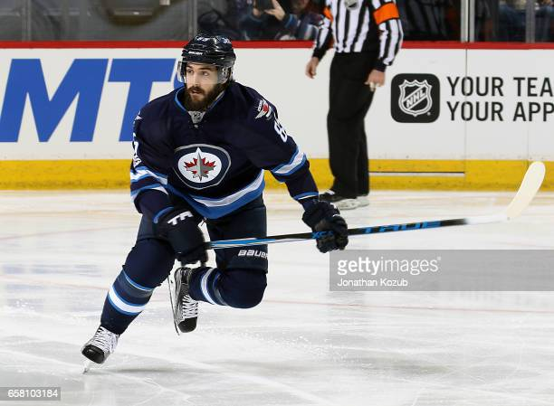 Mathieu Perreault of the Winnipeg Jets follows the play up the ice during first period action against the Vancouver Canucks at the MTS Centre on...